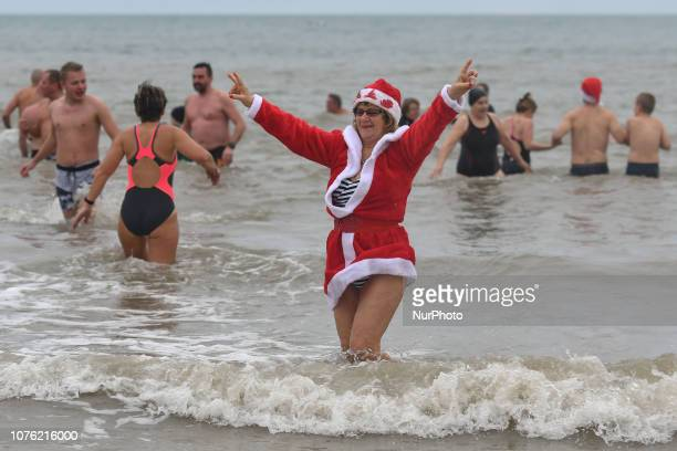 People participate in the last sea plunge of the year 2018 in Courseulles-Sur-Mer. On Monday, December 31 in Courseulles-Sur-Mer, Normandy, France.