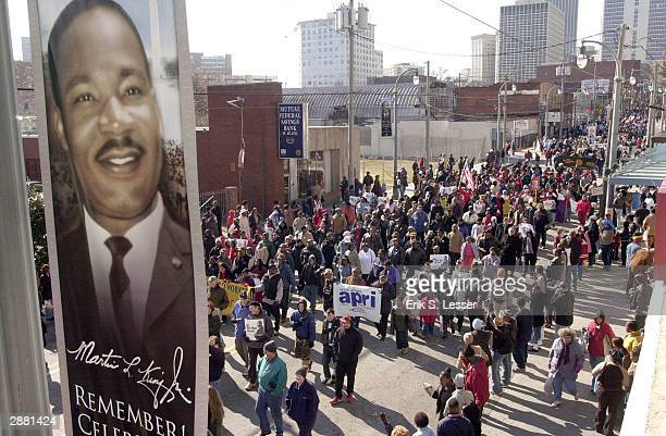 People participate in the Martin Luther King Jr Day march as they celebrate his national holiday January 19 2004 in Atlanta Georgia January 15 would...