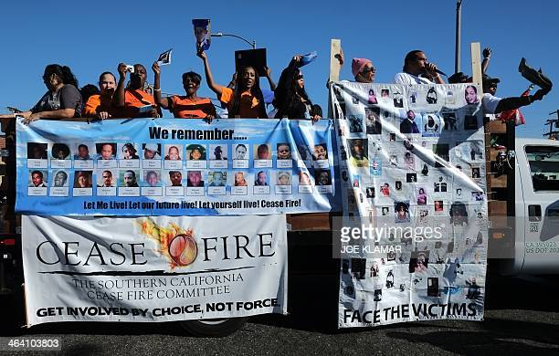 People participate in the Martin Luther King Jr parade in Los Angeles California on January 20 2014 The 29th annual Kingdom Day Parade honoring...