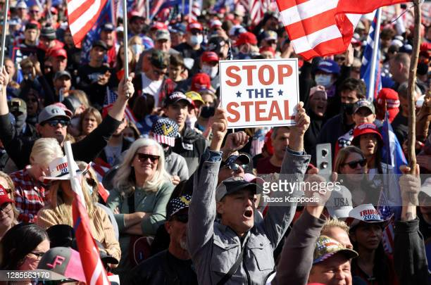 """People participate in the """"Million MAGA March"""" from Freedom Plaza to the Supreme Court, on November 14, 2020 in Washington, DC. Supporters of U.S...."""