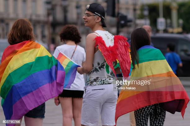 People participate in the Paris Gay Pride Parade or known as Marche des Fiertes LGBT in France on June 24 2017 in Paris France
