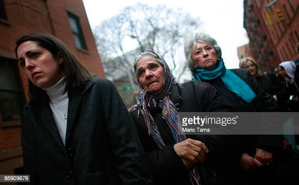People participate in the Stations of the Cross during a Good Friday procession in the Little Italy neighborhood April 10, 2009 in New York City....