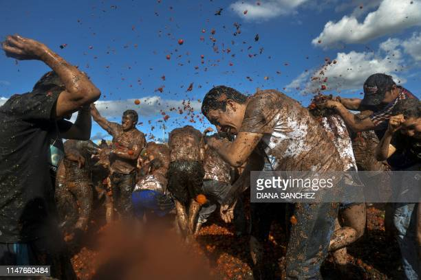 """People participate in the tenth annual tomato fight festival, known as """"Tomatina"""", in Sutamarchan, Boyaca department, Colombia, on June 2, 2019."""