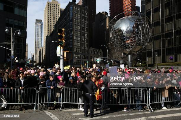 People participate in the Women's March in Columbus Circle in New York United States on January 20 2018