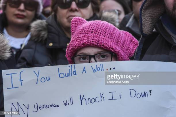 People participate in the Women's March on January 20 2018 in New York City Across the nation hundreds of thousands of people are marching on what is...