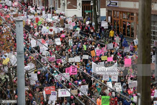 TOPSHOT People participate in Women's March 20 one year after women worldwide marched for women's rights and to protest US President Donald Trump's...