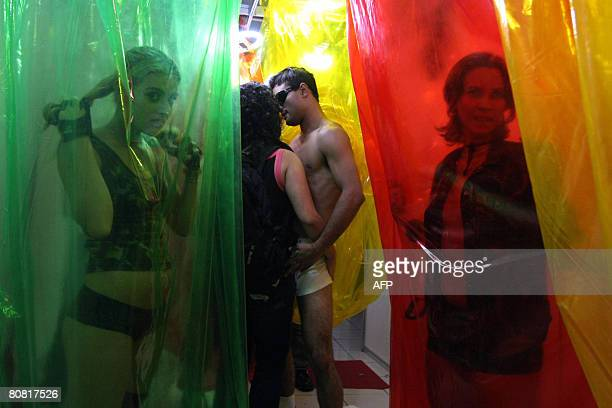 People participate on April 19 2008 in the 12th Erotika Fair Latin America's biggest erotica trade show held at the exhibition hall Mart Centre in...