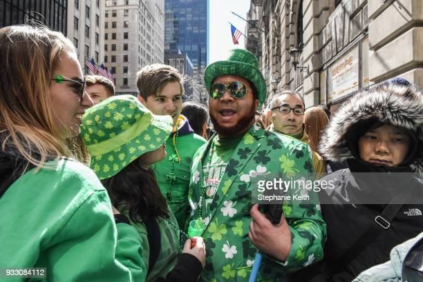 People participate on the sidelines of the annual St Patrick's Day parade along 5th Ave on March 17 2018 in New York City New York's Saint Patrick's...