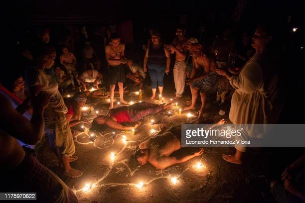 People participates in a healing ritual called Velación at night during a spiritual ritual in a portal in the mountain of Maria Lionza at Sorte on...