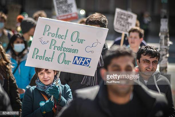 People participating in a demonstration which took place between Manchester Royal Infirmary and Albert Square in central Manchester Greater...
