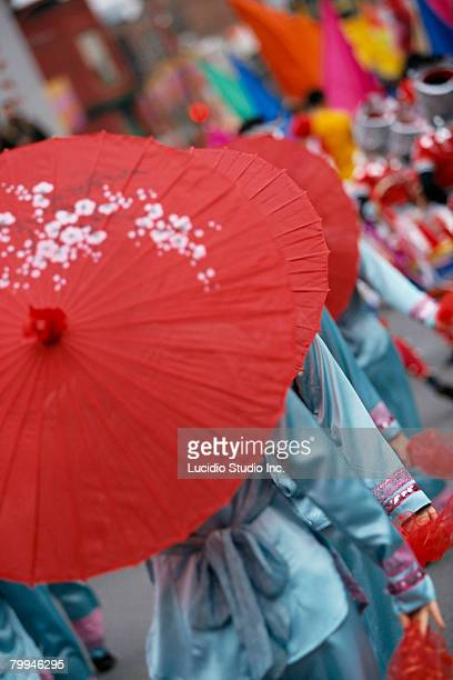 people participating in parade in vancouvers chinatown - chinatown stock pictures, royalty-free photos & images