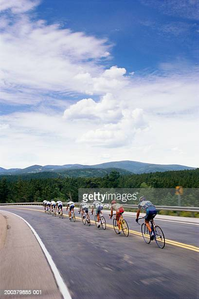 People participating in Rocky Mountains road race, rear view