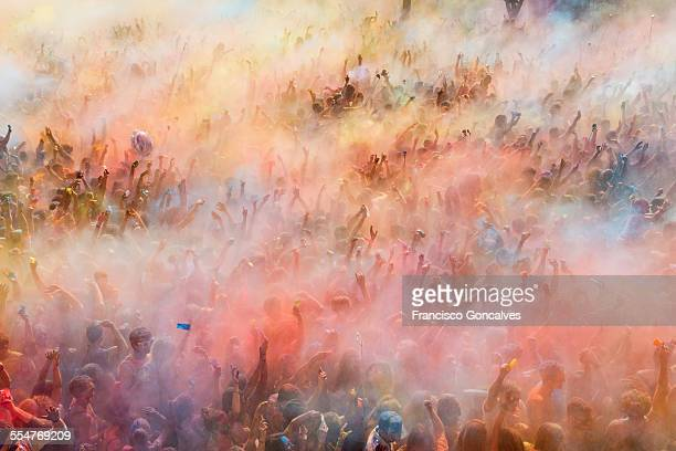 people participating in the holi festival - cultures stock pictures, royalty-free photos & images