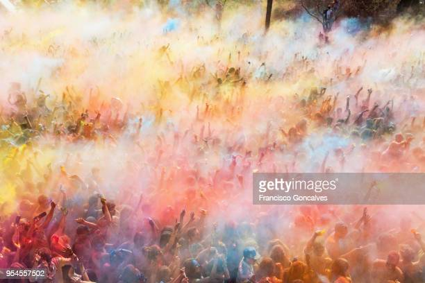 people participating in the holi festival - holi stock pictures, royalty-free photos & images