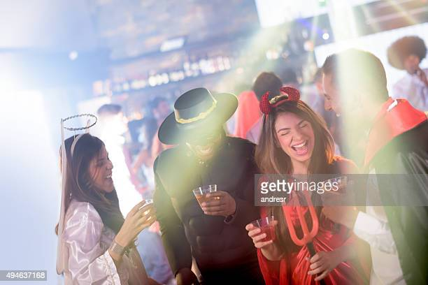people partying in halloween - halloween party stock photos and pictures