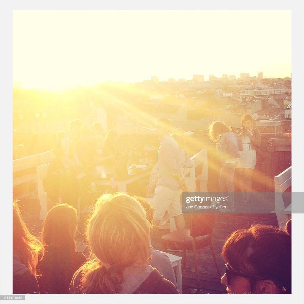 People partying on roof : Stock Photo