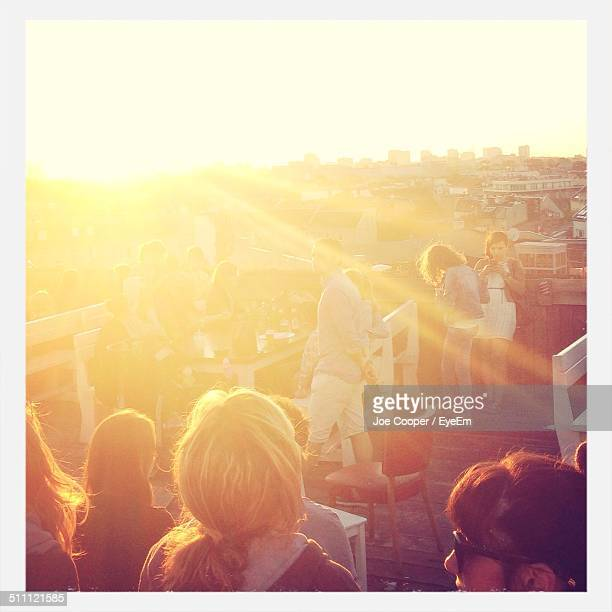people partying on roof - overexposed stock pictures, royalty-free photos & images