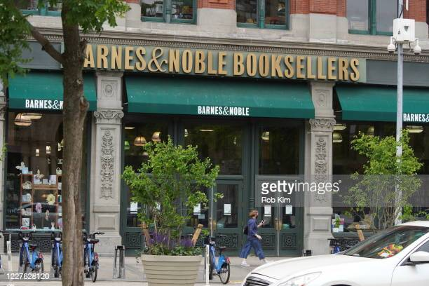 People pass a closed Barnes & Noble book store in Union Square during the coronavirus pandemic on May 28, 2020 in New York City. Government...