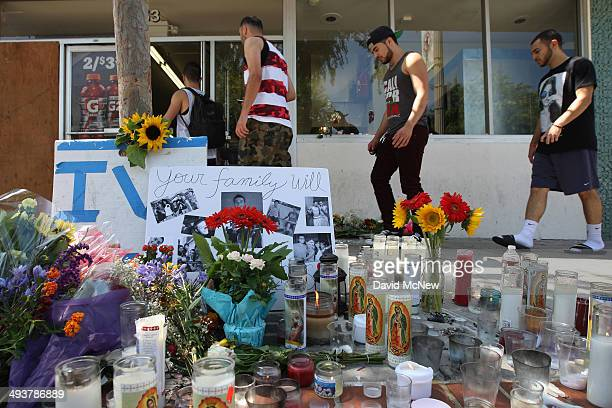 People pass a makeshift memorial to enter the IV Deli May 25, 2014 in Isla Vista, California. According to reports, 22 year old Elliot Rodger, son of...