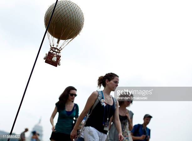 People pass a model of an American Civil Warera observation balloon during a demonstration on the National Mall June 11 2011 in Washington DC...