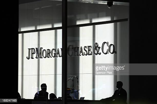 People pass a sign for JPMorgan Chase Co at it's headquarters in Manhattan on October 2 2012 in New York City New York Attorney General Eric...