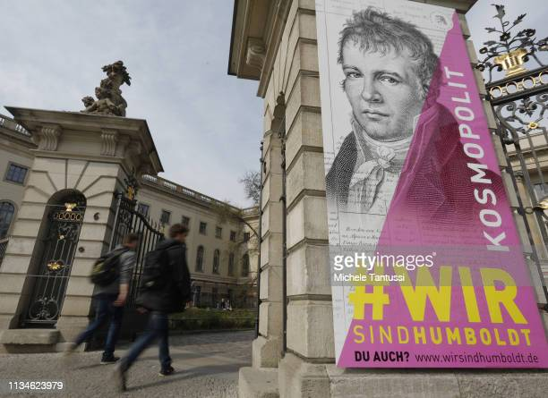 People pass by a Billboard showing an image of Prussian explorer geographer and natural scientist Alexander von Humboldt at the entrance of the...
