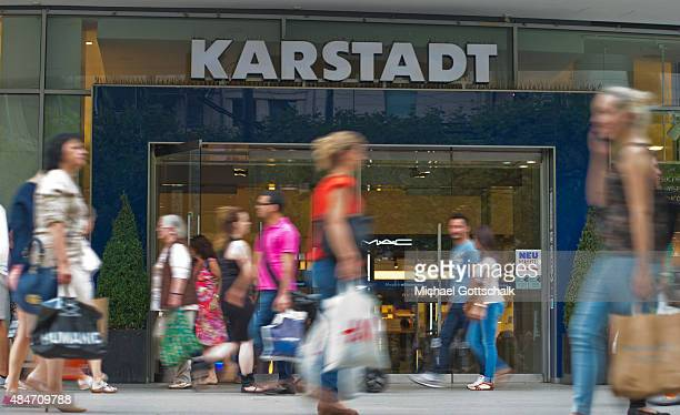 People pass by a branch of Karstadt department store on August 14 2015 in Frankfurt Germany
