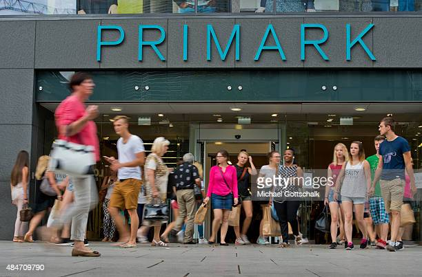 People pass by a branch of Primark department store on August 14 2015 in Frankfurt Germany