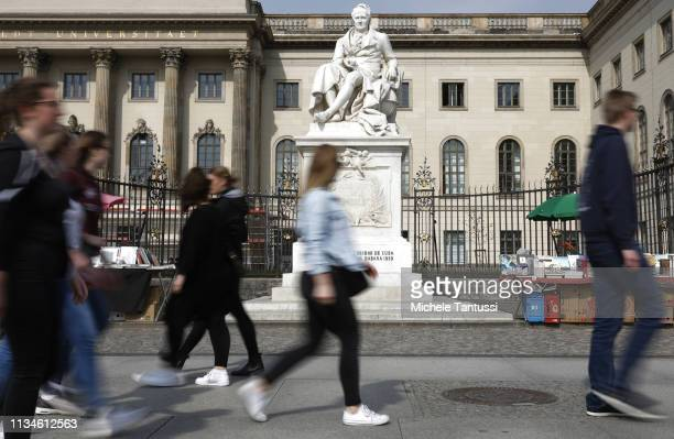 People pass by a memorial to Prussian explorer geographer and natural scientist Alexander von Humboldt next to Humboldt University on April 3 2019 in...