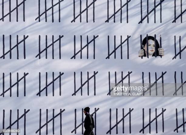 TOPSHOT People pass by a new 70footlong mural by anonymous British artist Banksy on March 16 2018 that was unveiled on March 15 2018 at the corner of...