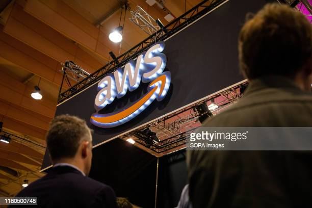 People pass by AWS stand during the day 3 of the annual Web Summit technology conference in Lisbon.