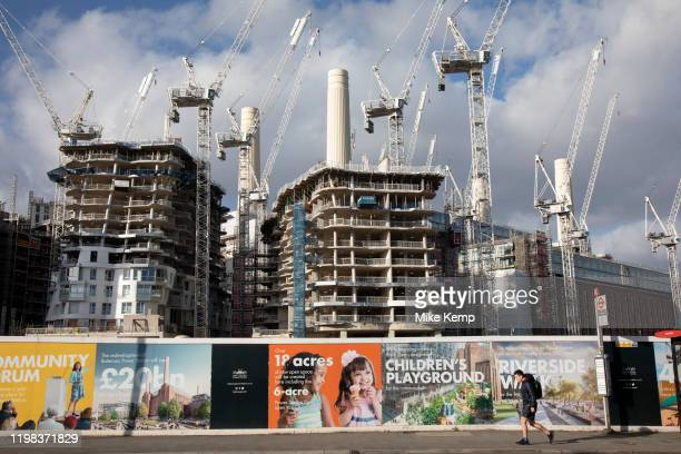 People pass by near the redevelopment of Battersea Power Station and its surroundings on 1st February 2020 in London England United Kingdom Battersea...