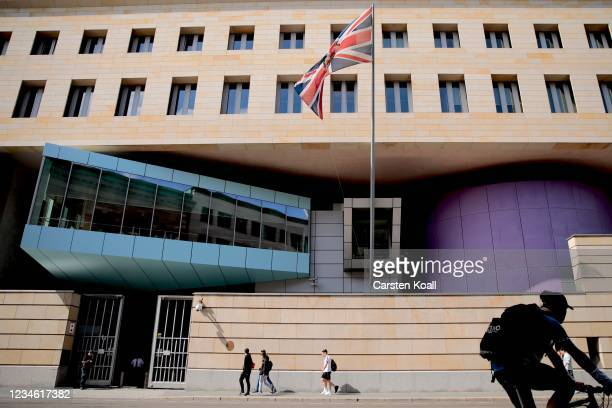 People pass by outside the British Embassy on August 11, 2021 in Berlin, Germany. German law enforcement authorities announced today that they have...