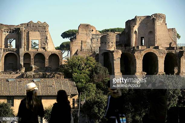People pass by the Arcate Severiane on the Palatine hill of Rome on November 11 2009 AFP PHOTO / ALBERTO PIZZOLI