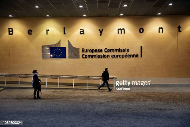 People pass by the Berlaymont building European Commission headquarter in Brussels Belgium on January 14 the day ahead of crucial UK Parliament...