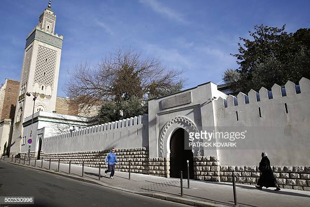 People pass by the entrance to the AlGhazali theology institute of the Grand Mosque of Paris on December 19 2015 / AFP / PATRICK KOVARIK