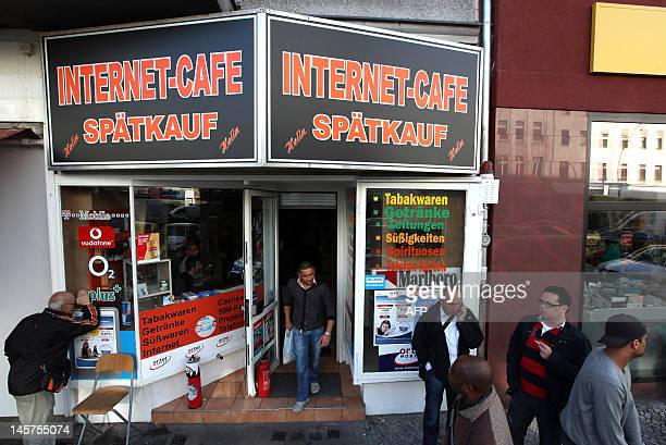 """People pass by the Internet Cafe in the Neukoelln district of Berlin, on June 4, 2012 where Luka Rocco Magnotta dubbed the """"Canadian Psycho,"""" who is..."""