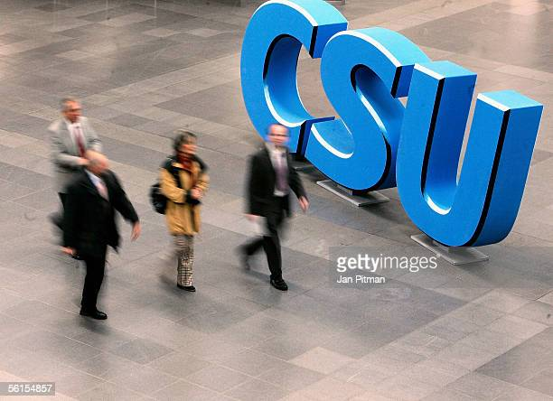 People pass by the logo of the Christian Social Union before the party convention of the CSU party on November 14 2005 in MUnich Germany The CSU...