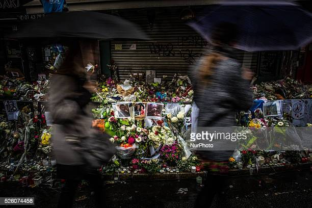 People pass by the memorial in quotLa Belle Equipequot restaurant in the 11th district of Paris on November 21 2015 following a series of coordinated...