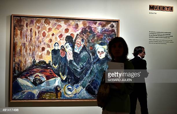 People pass by the painting 'Death Struggle' by Norwegian artist Edvard Munch during the exhibition titled 'Arquetipos' of Norwegian artist Edvard...
