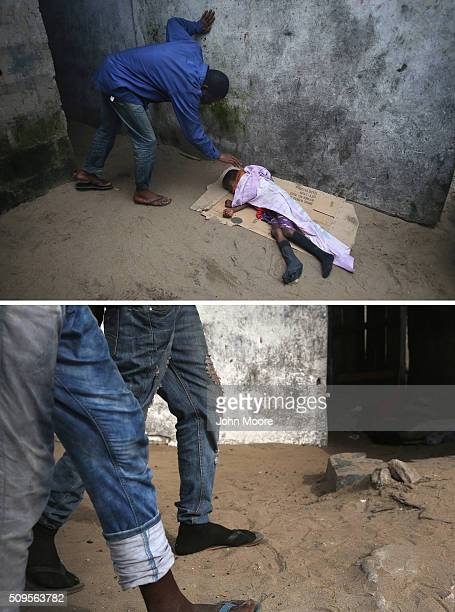 A local resident checks on a very sick Saah Exco in a back alley of the West Point slum on August 19 2014 in Monrovia Liberia The boy was one of the...