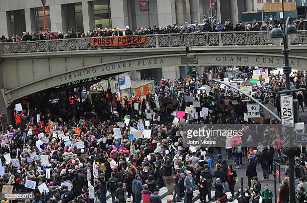 People pass Grand Central Station while taking part in the Women's March on January 21 2017 in New York City The Midtown Manhattan event was one of...