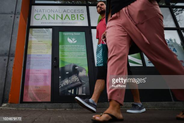 People pass in front of the National Access Cannabis office ready to be open in Edmonton a unique Health Care service provider that specializes in...
