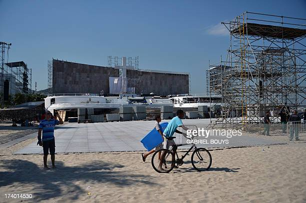 People pass in front of the podium to receive Pope Francis at Copacabana beach in Rio de Janeiro, Brazil on July 19, 2013. More than 1.5 million...