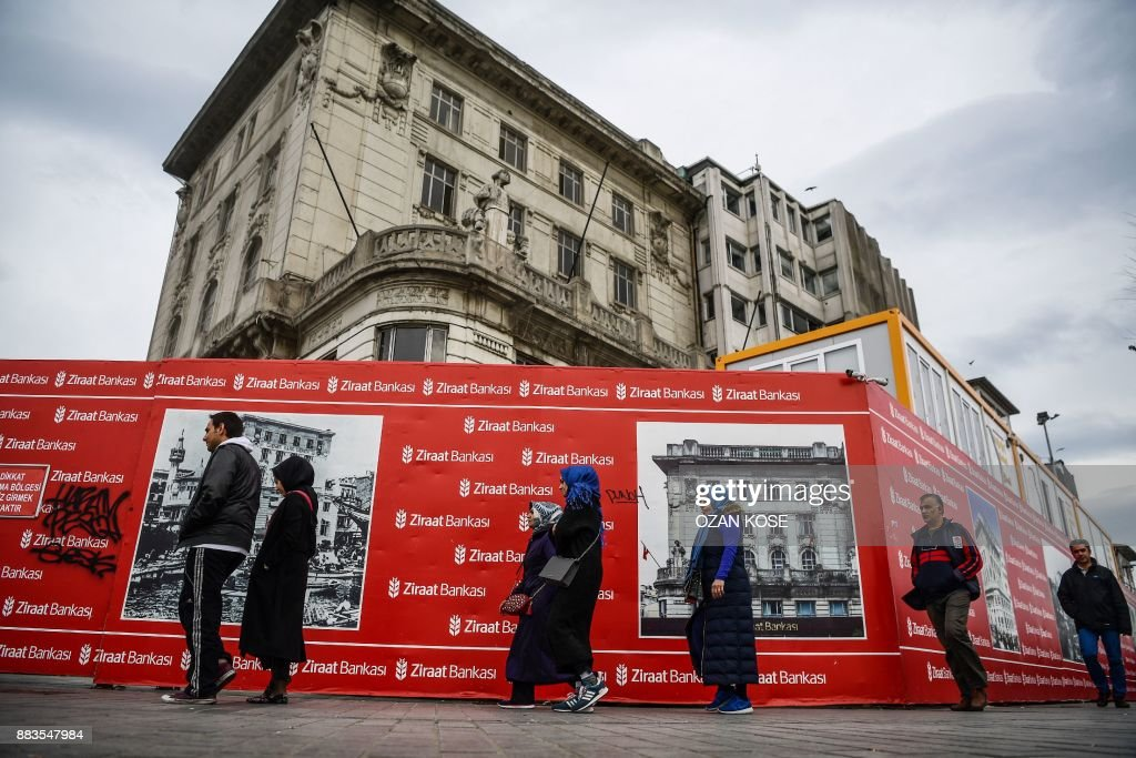 People Pass In Front Of The Turkish Ziraat Bank Building On December 1 2017 At