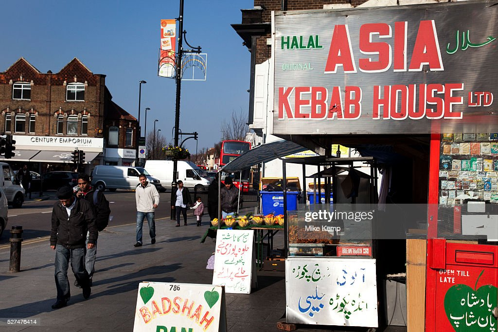 People pass the Asia Kebab House in Southall in West London also known as `Little India` by some is an area almost completely populated by people...
