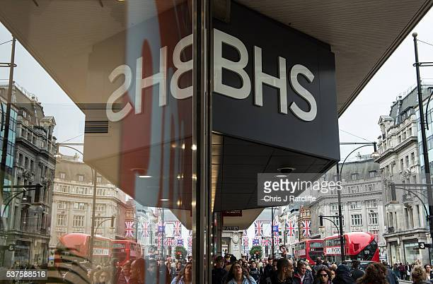 People pass the BHS store on Oxford Street as it has been anounced that the company will go into liquidation on June 2 2016 in London England The...