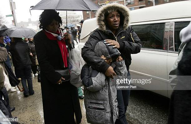 People pass the hearse carrying the body of Nixzmary Brown after her funeral January 18 2006 in New York City Brown was found beaten to death last...
