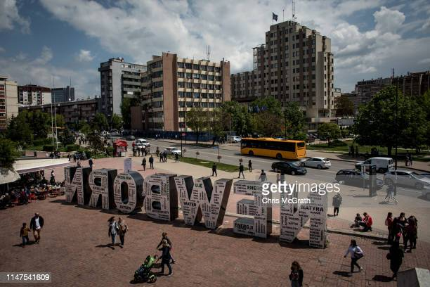 People pass the NEWBORN Monument unveiled on February 17, 2008 the day Kosovo formally declared independence from Serbia on May 2, 2019 in Pristina,...