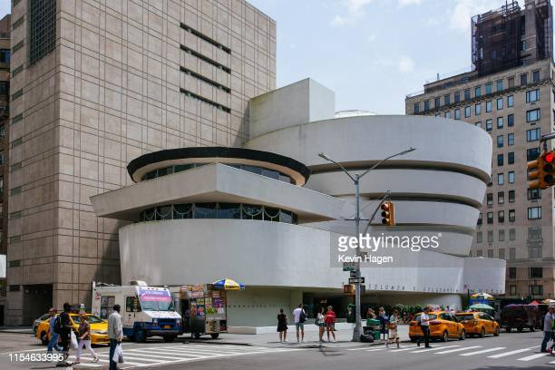 People pass the Solomon R. Guggenheim Museum on July 8, 2019 in New York City. Designed by architect Frank Lloyd Wright, UNESCO has named the...